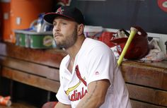 FILE - In this Oct. 2, 2016, file photo, St. Louis Cardinals left fielder Matt Holliday sits in the dugout after leaving a baseball game against the Pittsburgh Pirates during the ninth inning in St. Louis. A person familiar with the negotiations says free agent Holliday and the New York Yankees have agreed to a $13 million, one-year contract. The person spoke on condition of anonymity Sunday night, Dec. 4, 2016, because the agreement had not yet been announced. (AP Photo/Jeff Roberson, File)