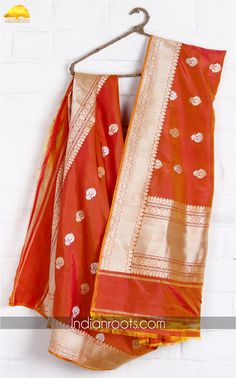 Orange handwoven banarasi silk dupatta by Weavers Studio on Indianroots.com