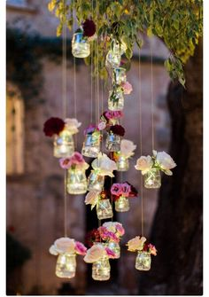 Suspended bud vases filled with blush and burgundy blooms