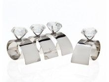 These contemporary napkin rings feature a band of silver-plated metal that holds a faux diamond - great touch with a bit of whimsical style. Set of 4 napkin rings with diamond motif. Style # at Lamps Plus. Diamond Stone, Diamond Rings, Silver Napkin Rings, Wedding Place Settings, Whimsical Fashion, Table Linens, Candlesticks, Wedding Gifts