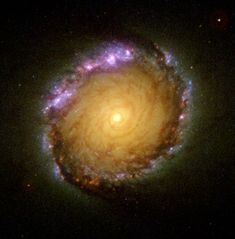 NGC 1512 - This active barred spiral galaxy is about 30 million light-years away in the constellation Horologium; the active star-formation regions in the heavy dust lanes