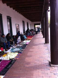Santa Fe, NM -- Saturday Market in old Sante Fe. Gorgeous, romantic, town that I always go back to. Each Saturday locals come into the square and sell their wares on blankets. Beautiful silver and turquoise jewelry, pottery, leather goods, etc.