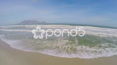 Aerial Shot Pull Back Over Waves Sandy Beach Table Mountain South Africa Drone - Stock Footage | by RyanJonesFilms #aerial #drone #quadcopter #sea #beach #ocean #waves #aerialshot #gopro #phantom #tide #water #sand #travel #horizon #capetown #southafrica #tablemountain