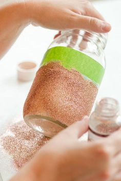 DIY glitter vases from The Sweetest Occasion... Would be great for candles on a table =)