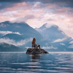 """Photo by BC #guestagrammer @elizabethgadd: """"Once again, Alouette Lake never fails to look beautiful on any given day.  On this particular morning in February, I couldn't resist wading though the freezing water to this rock for a self-portrait.  It might not have been the best idea considering I got a bad cold that day which lasted for weeks, but was it worth it? Yes!"""" #exploreBC #explorecanada"""
