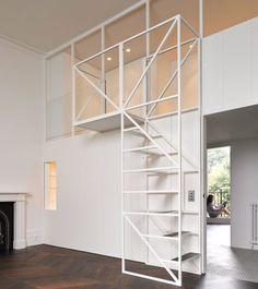 """Wireframe staircase leads to mezzanine sleeping """"nest"""" in west London flat renovation"""