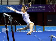 olympic gymnastics, uneven bars, sports photography