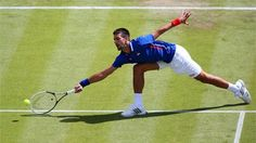 Novak Djokovic of Serbia plays a forehand during the men's Singles Tennis match against Fabio Fognini of Italy on Day 2 of the London 2012 Olympic Games at Wimbledon.The second seed was made to work for his first round win in three sets 6-7 6-2 6-2.