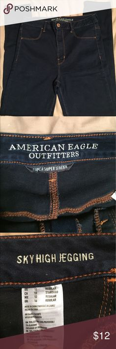 American Eagle sky high rise jeggings American Eagle sky high rise jeggings. These things are a miracle worker. The sky high rise sucks in all that stuff you want to hide 😁 super flattering since they are a dark color. Some wear on inside of thighs. American Eagle Outfitters Jeans Skinny