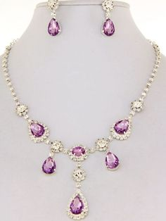 Amethyst Silver Teardrop Necklace and Earring Set. 10 ~15 Mm Diameter Teardrop Design with Rhinestones. 1 Inch Long Earrings. Lobster Claw Closure. Post Earrings. 16 Inch Necklace Length. Hail Mary Gifts,http://www.amazon.com/dp/B00EF8NEZQ/ref=cm_sw_r_pi_dp_58fpsb15C2QK5FS9