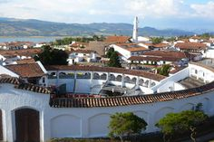 Discover Guatavita la Nueva in Guatavita, Colombia: The entire town looks like a slice of Spain that was carted across the ocean and plunked in the Andes. Travelogue, Small Towns, Spain, Mansions, House Styles, World, Atlas, Bella, Letters
