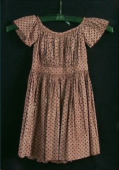 Little boy's printed tan cotton dress, American, 1853-54. Worn by John Bradley Winslow (1851-1920) and made by his mother Emily (Bradley) Winslow (1823-1877) of Nunda, NY. J.B. Winslow received a law degree from UW-Madison in 1875. He served on the Wisconsin Supreme Court starting in 1891, and was Chief Justice from 1907-1920.