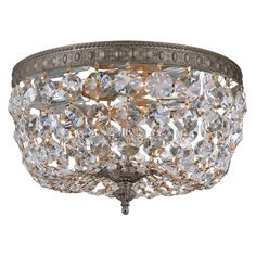 Bring glittering style to your living room, dining room, or foyer with this elegant flush mount, featuring a cast brass frame and beaded crystal shade.