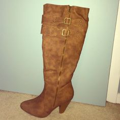 Faux leather boots Brown faux leather boots worn once! Few small white paint specs on right boot as shown Shoes Heeled Boots