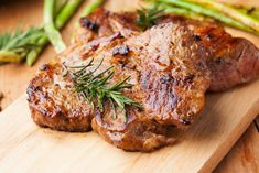 The perfect inexpensive and hearty meal! These flavorful and tender pork chops pair perfectly with your favorite vegetable or starch. With just six ingredients, this recipe is a breeze! Pork Chop Recipes, Healthy Crockpot Recipes, Pork Meals, Grilled Recipes, Parmesan Recipes, Grilled Pork, Paleo Recipes, Healthy Food, Balsamic Pork Chops