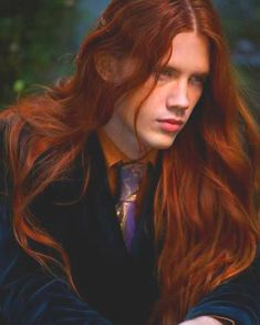 Bartek Borowiec, long haired model. Redheaded men with long hair are rare.