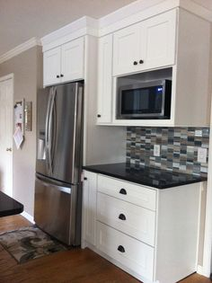 Microwave shelf and fridge. Might be able to do this above the sink in our kitchen.