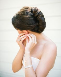 For a chic, structured look, Katie Brooke Callahan pulled the bride's hair back into this sleek twist. A style like this would stay put all day and all night, no matter if it were windy or you got crazy on the dance floor. Wedding Hairstyles For Long Hair, Bride Hairstyles, Down Hairstyles, Bridesmaid Hairstyles, Casual Wedding Hair, Diy Wedding Hair, Chic Wedding, Bridal Hairdo, Bridal Hair And Makeup