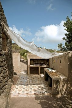 Today's weekend escape takes us to Pantelleria, an Italian island in the Mediterranean Sea, 100 km southwest of Sicily. This dream home has been designed by Studio Albanese, an architecture firm from Outside Living, Outdoor Living, Parrilla Exterior, Outdoor Spaces, Outdoor Decor, Rustic Outdoor, Outdoor Kitchen Design, Outdoor Kitchens, Küchen Design