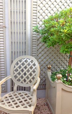 Beth's side garden is perfect for entertaining. Accents of France lattice.