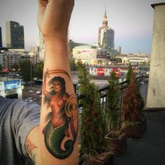 The Warsaw Mermaid on a Warsaw evening. @caffeinetattoo