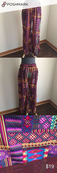"Fashion Fuse flowy bright graphic pants sz L NWOT Fashion Fuse lightweight flowy bright graphic print pants, size L.  Wide elastic waistband, side pockets, wide legs.  Condition:  new without tags (NWOT).  Material:  100% polyester.  Measurements (approximate, taken laying flat):  length 41"", inseam 29.5"", front rise 11.5"", flat unstretched waistband 15"", flat hip 22"". Fashion Fuse Pants"