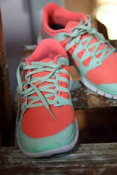 Coral and mint Nike shoes