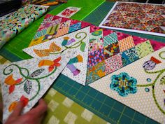 Triangle border with patchwork and appliqué blocks via Material Obsession