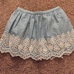 Abercrombie and Fitch girls sz lg, lace trim Abercrombie and Fitch girls sz lg (youth) chambray skirt lace trim cut outs around bottom. Like new! Super cute! Abercrombie & Fitch Skirts Mini