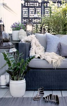 Urban Chic cozy outdoor living space on your deck. So beautifully designed including the Black privacy screen.