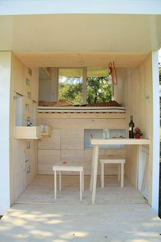 "The ""Spirit Shelter"" - a tiny structure designed for self-reflection, has lofted bed and study spaces that cantilever over the main floor - interior - photos / floorplan  : SmallHouseBliss  #1"