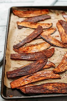 Crispy vegan bacon made with eggplant! Sliced eggplant is brushed with a smoky sauce and baked to perfection! A tasty, plant-based bacon alternative.