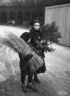 Scandinavian Children bringing home traditional Christmas decor, exact year unknown.