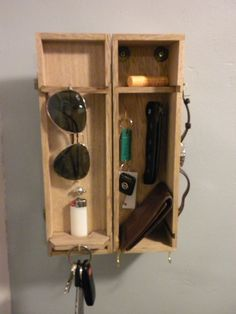 DIY cigar boxes hung for for keys and men's personal items. Cigar boxes available at http://shopjunket.com/?s=cigar+box_type=product