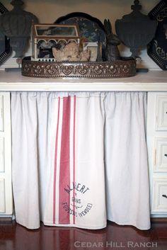 Make a kitchen skirt from a feed sack or kitchen towel! www.cedarhillfarmhouse.com