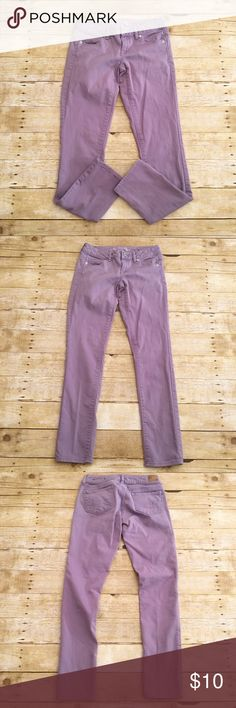 Light purple American Eagle skinny jeans, size 4 Good used condition American Eagle skinny jeans, stretch, regular 4. Not high waist. Normal wash wear. One tiny spot on one of the legs. American Eagle Outfitters Jeans Skinny