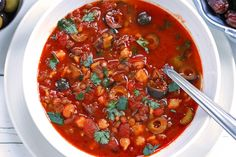 The national soup of Morocco, this Harira recipe is a total flavor explosion. It's no wonder it's such a popular soup, it will WOW your taste buds! Vegan Soups, Vegan Vegetarian, Harira Recipe, Harira Soup, Moroccan Stew, Food Tags, Middle Eastern Recipes, Lentil Soup, International Recipes