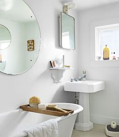 The tub, mirror, and sink are original in this century-old bathroom.