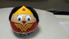Painted Wonder Woman pumpkin with black wig, card stock crown, and gold wire lasso, for work pumpkin contest Halloween Crafts For Kids, Craft Projects For Kids, Cute Halloween, Halloween Pumpkins, Fall Crafts, Holiday Crafts, Holiday Fun, Halloween Decorations, No Carve Pumpkin Decorating