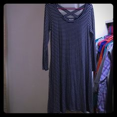 Cute dress or swim cover up! This adorable dress has been worn a couple times but in perfect condition! Can be used as a swim cover up. It is navy blue and white striped with an x back detail. Size small on tag but fit more like a L or Xl. Prices negotiable and free item with every purchase! Dresses Midi