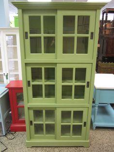 """Pistachio green sliding doors cabinet.  Measures: 43""""W x 17""""D x 82""""H. $726."""