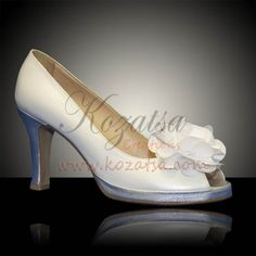 Jodie - Pearly white soft leather peep toes with a 1cm platform and a silver shaded heel, decorated with a white satin flower bow.