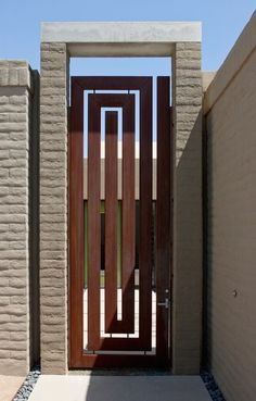A Corten steel gate in a Grecian key pattern by architect Teresa Rosano in Tucson, Arizona