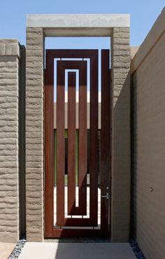 A Corten steel gate in a Grecian key pattern by architect Teresa Rosano in Tucson, Arizona