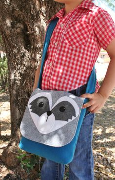 Handmade raccoon messenger bag from the Savage Seeds Woodland Creature collection.