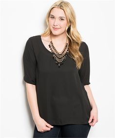 Black top features a semi-sheer front and sleeves with a scallop crochet design covering the whole back. Wear a black or contrasting cami to add style.