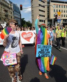 """""""Solidarity with Muslim LGBTQ"""" - A participant wears a rainbow-colored burka as she expresses solidarity with Muslim lesbian, gay, bisexual, trans*, and queer people during a gay pride parade in Warsaw, June 15, 2013. Photo credit: Janek Skarzynski / AFP"""