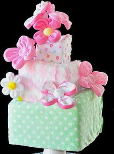 Download Washcloth Flower and Bouquet Instructional Video Sewing Pattern | Topsy Turvy Diaper Cake | YouCanMakeThis.com