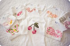 Cute fabric decorated onesies.