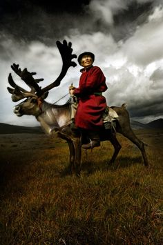 The Reindeer people of Mongolia 703-06: Sanjim who is the male elder of the Tsaatan who live high in the mountains of northern Mongolia. Faces his biggest fear which is that the young people may decide to leave the taiga, and that old people like him will end up alone. Sanjim rides his reindeer on their summer range. Donna Todd/Lightmediation